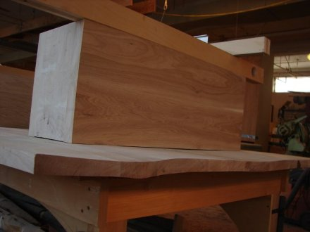 One of the base units being fit to the table top.