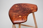 Carved walnut & maple stool. Etsy.