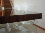 Detail of dining table with glass legs.