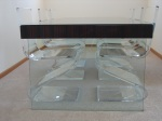 Dining table with glass legs.