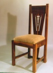 1 of a set of dining chairs.