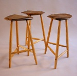 Set of 3 legged stools, walnut & oak.